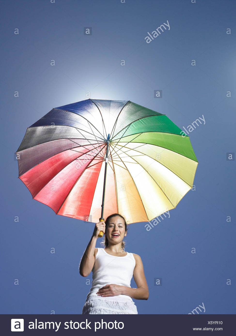 Girl holding sun parasol - Stock Image