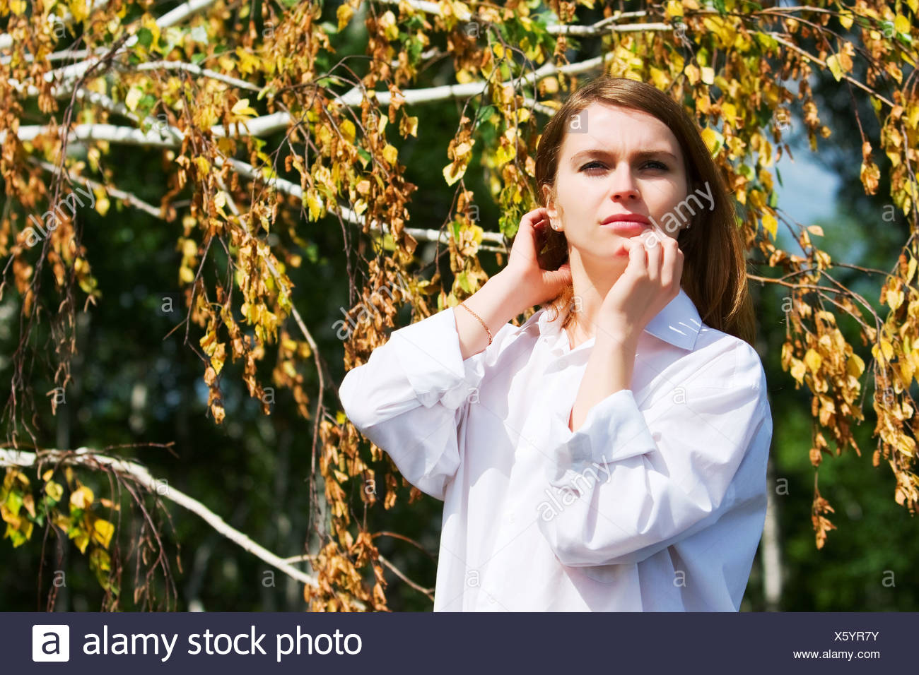Young woman relaxing on nature - Stock Image