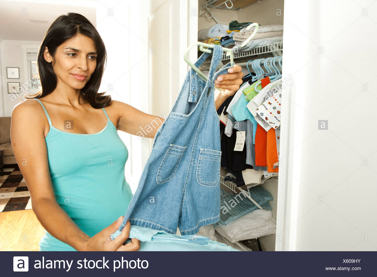 8123dca0d Pregnant woman holding baby clothes Stock Photo: 279061383 - Alamy