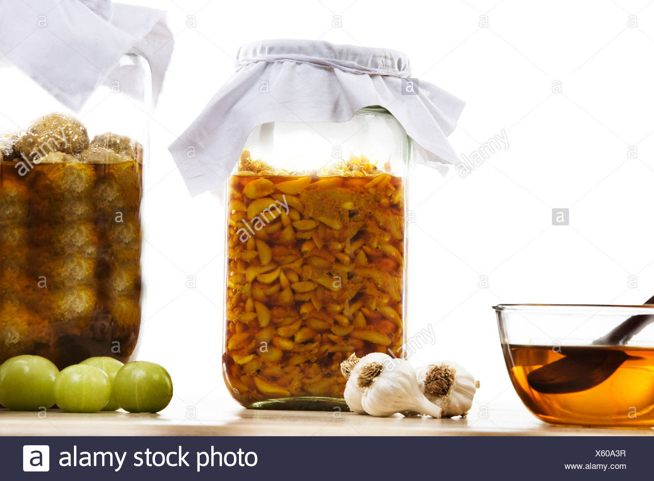 Jars filled with garlic and gooseberry pickle - Stock Image