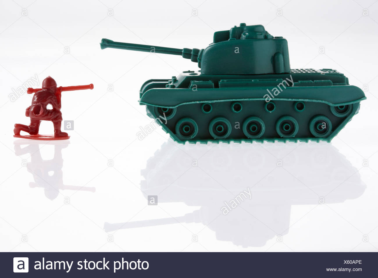 Toy army soldier and toy army tanks - Stock Image