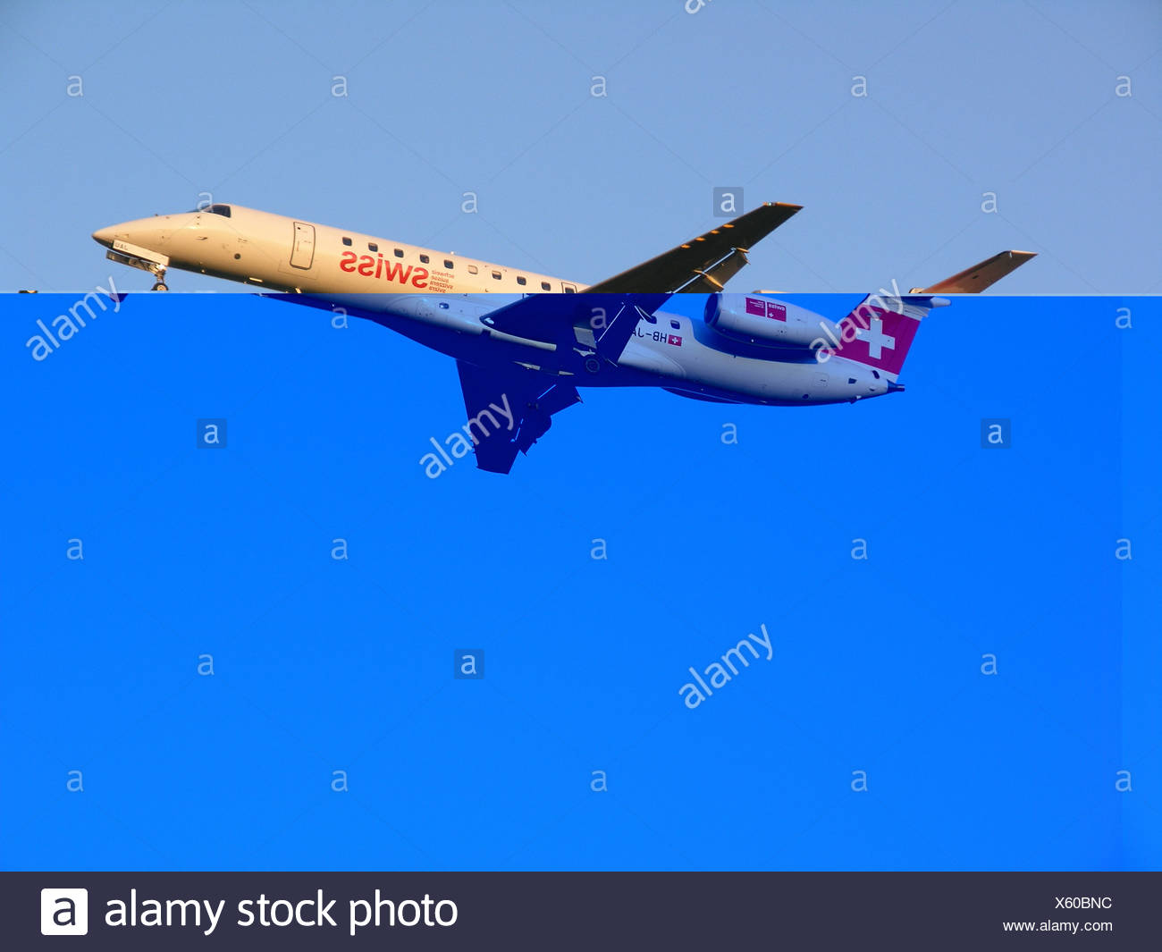 airplane Aviation Embraer 145 flight fly flying jet jet airplane sky Swiss Switzerland Europe - Stock Image