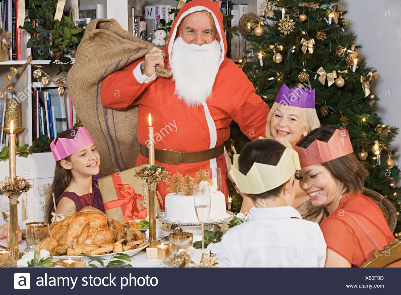 Santa claus at christmas dinner - Stock Image