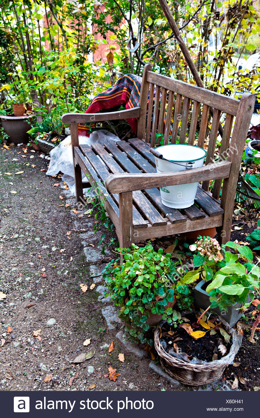 Outstanding Wooden Bench And Several Potted Plants In A Yard Autumn Caraccident5 Cool Chair Designs And Ideas Caraccident5Info