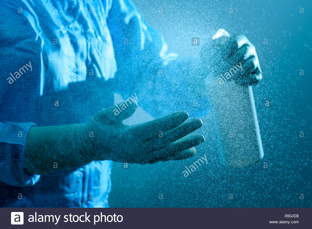 Midsection Of Person Spraying Antibacterial On Hands - Stock Image