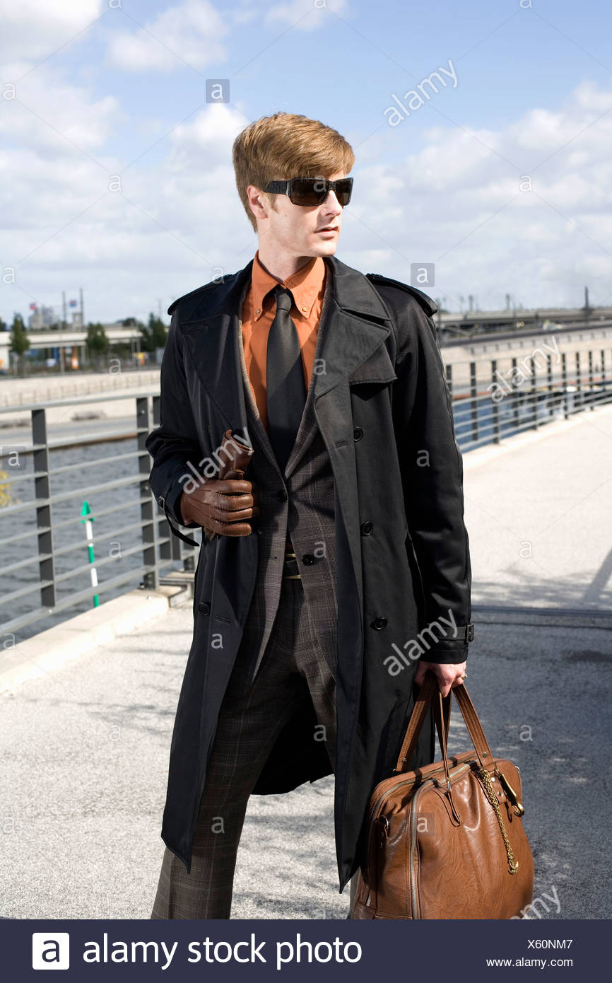 A businessman walking across a bridge Stock Photo