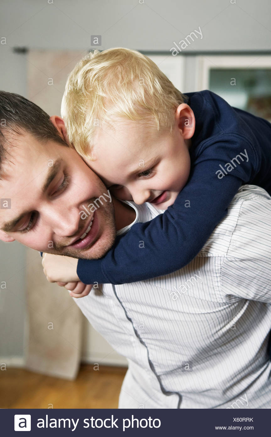 Boy and dad playing - Stock Image