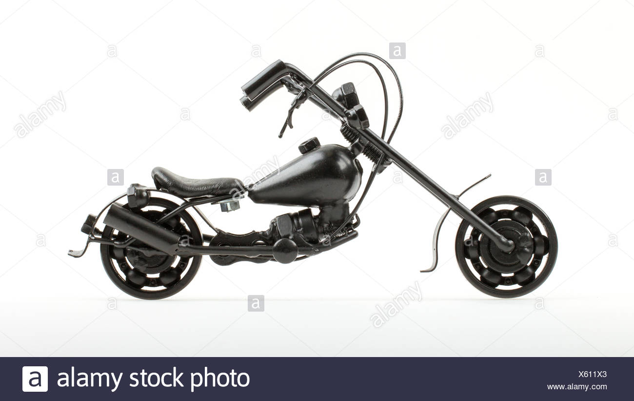 Mini motorcycle made from wire and different motorcycle parts - Stock Image