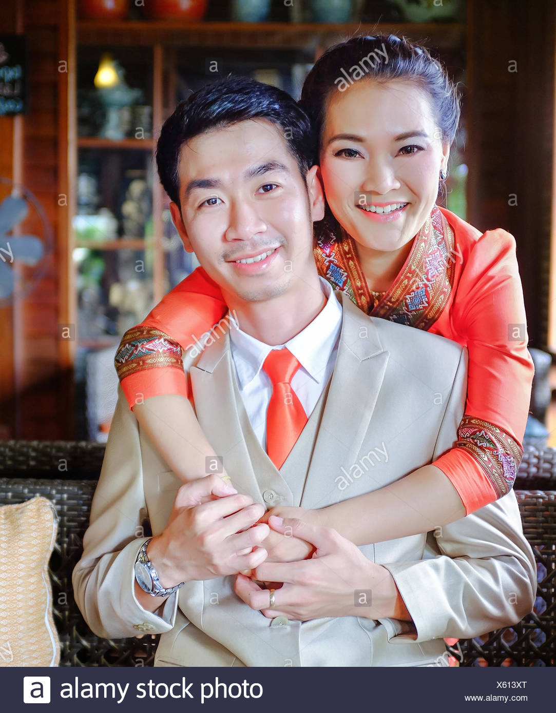 Portrait Of Happy Couple Embracing At Home - Stock Image
