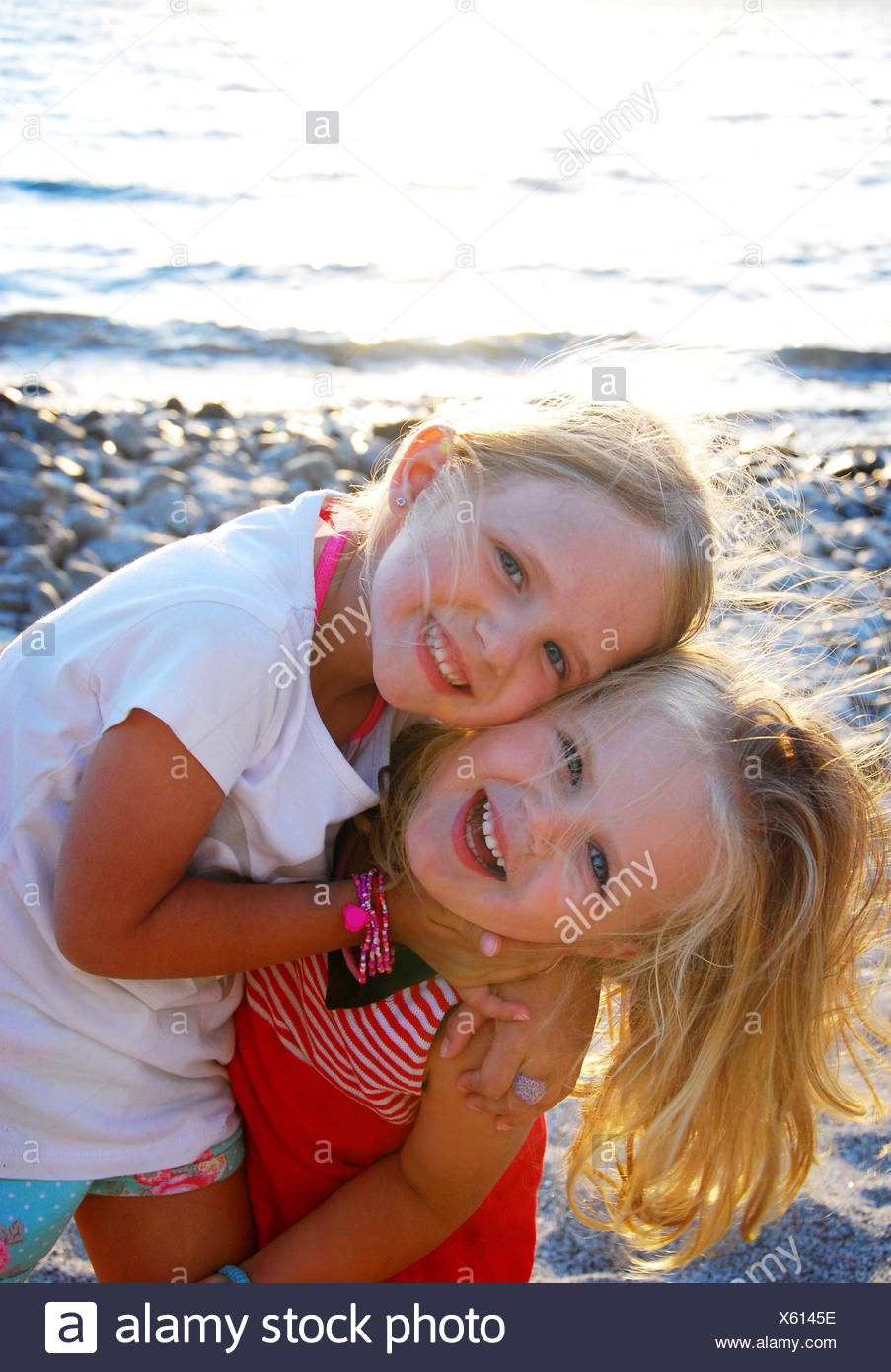 Argentina, Rio Negro, Sisters by lake - Stock Image