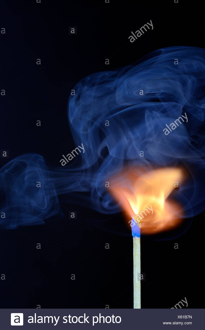 Match being lit, blue smoke - Stock Image