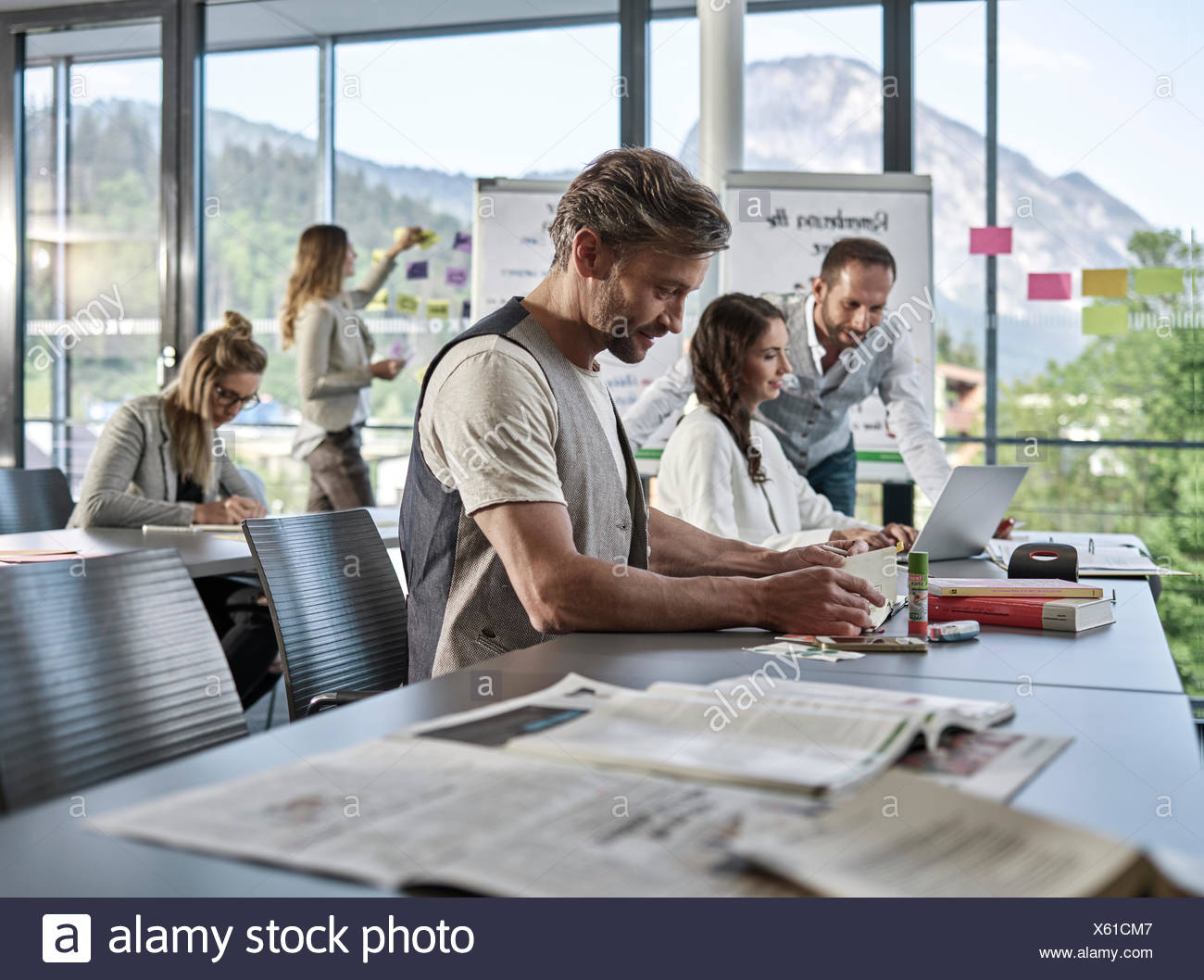 Creative teamwork, presentation, brainstorming, project work, workshop, training, seminar for executives, adult education Stock Photo