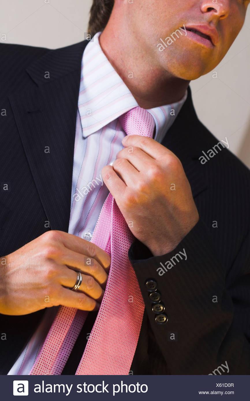 well dressed,tie,tying - Stock Image