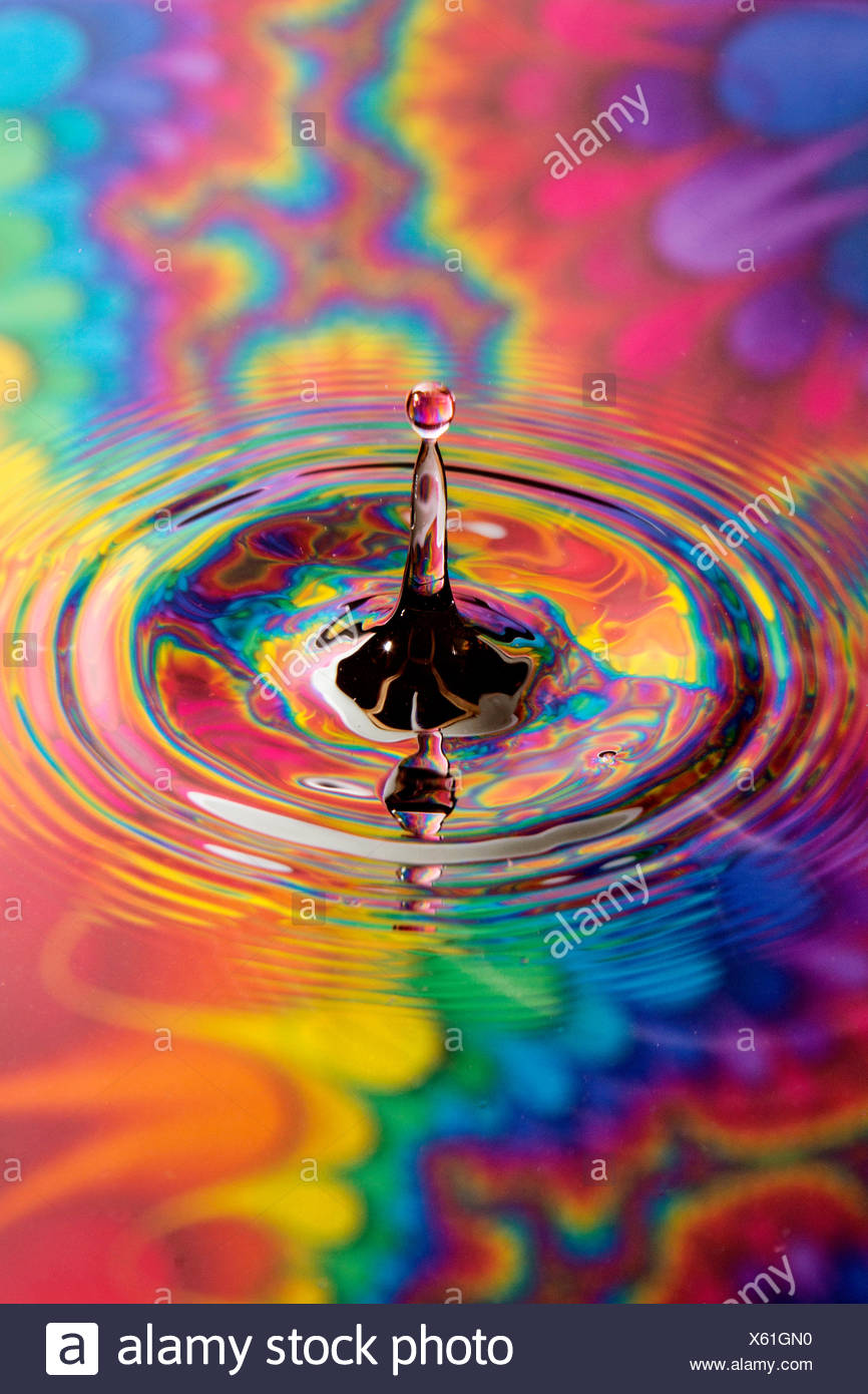 Water drop with colorful background - Stock Image