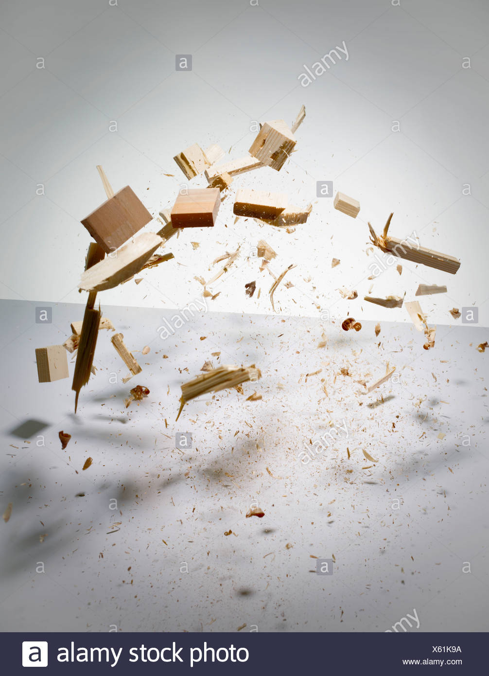 Wood exploding into pieces - Stock Image