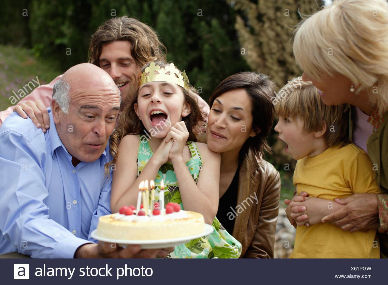 Young girl celebrating birthday with family - Stock Image