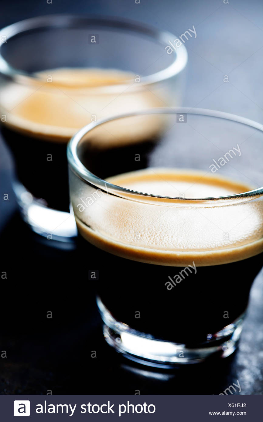 Cups of Espresso on dark rustic background - Stock Image