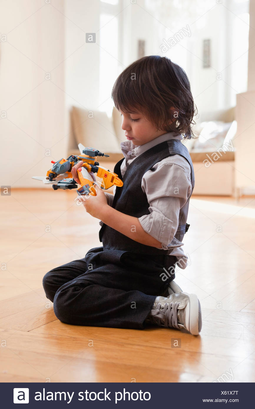 boy playing with toy - Stock Image