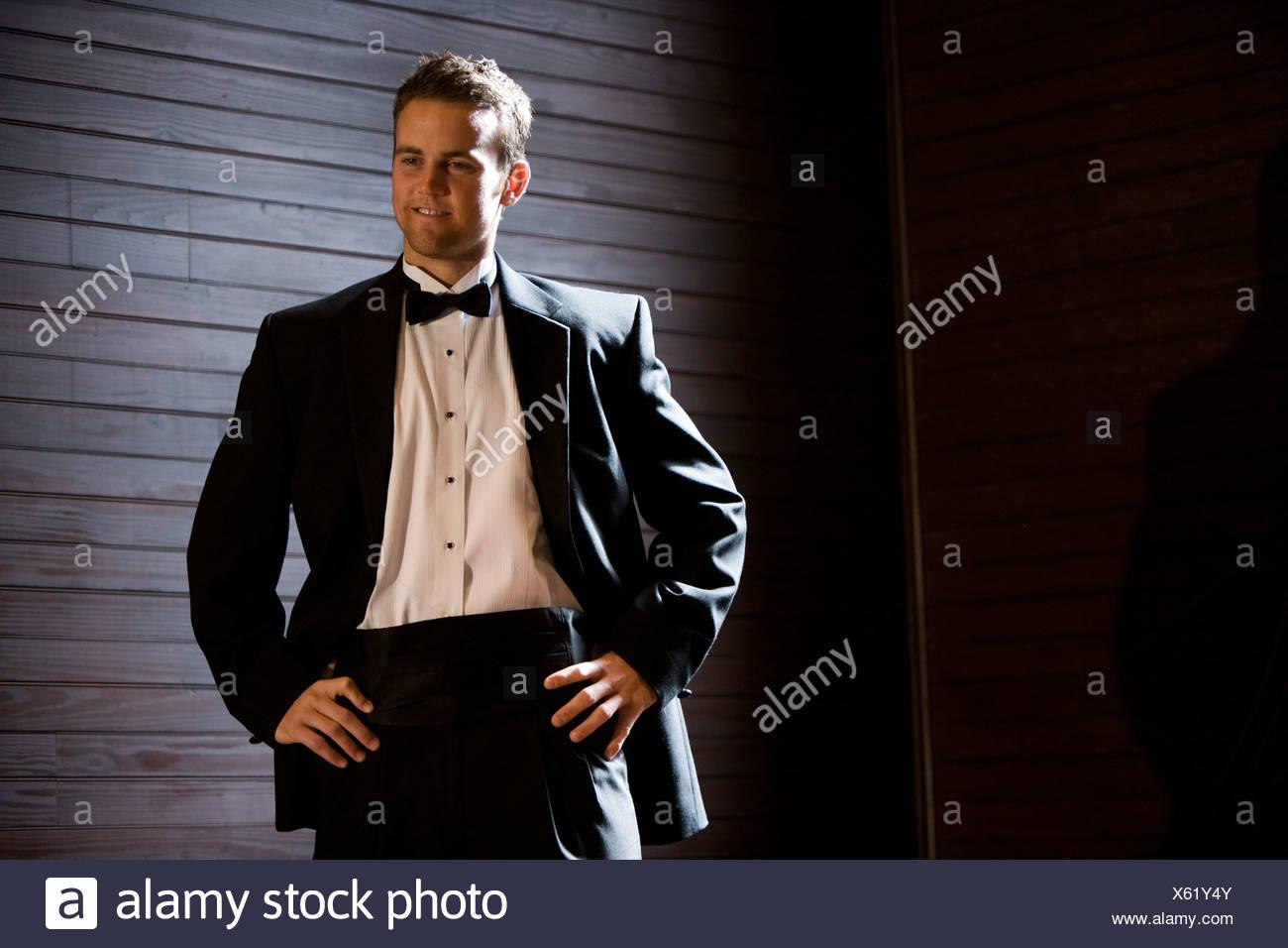 Young groom posing in tuxedo - Stock Image