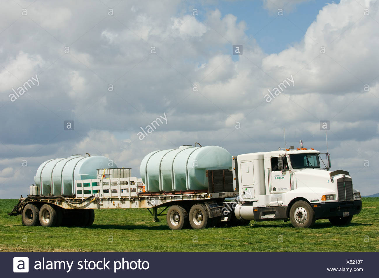 Truck loaded with chemicals to support spraying wheat fields for weeds / near Pullman, Palouse Region, Washington, USA. - Stock Image