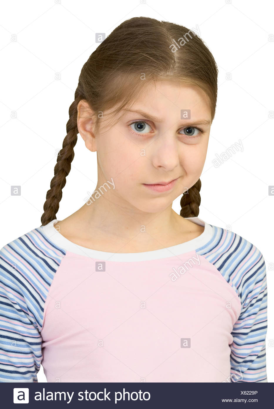 Skeptical teenager girl - Stock Image