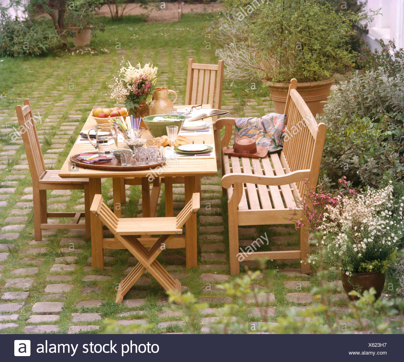 Superb Wooden Bench And Chairs At Table Set For Lunch On Patio In Pabps2019 Chair Design Images Pabps2019Com