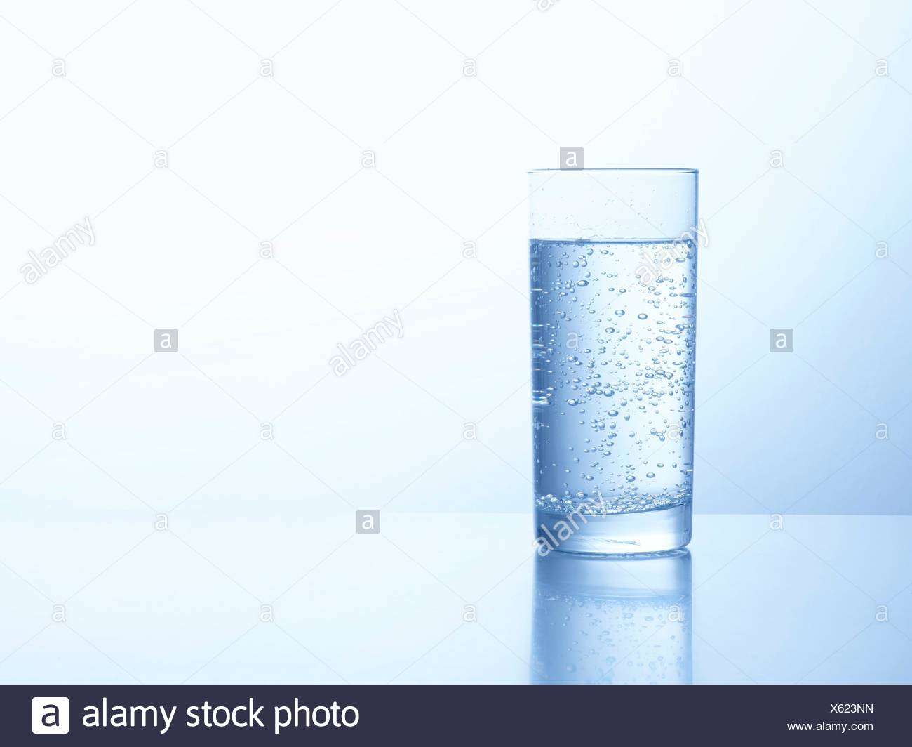 Glass of carbonated water, studio shot. - Stock Image