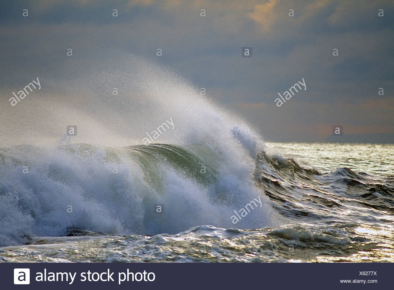 Scenic. Stormy sky over the Atlantic ocean with large wave breaking. - Stock Image