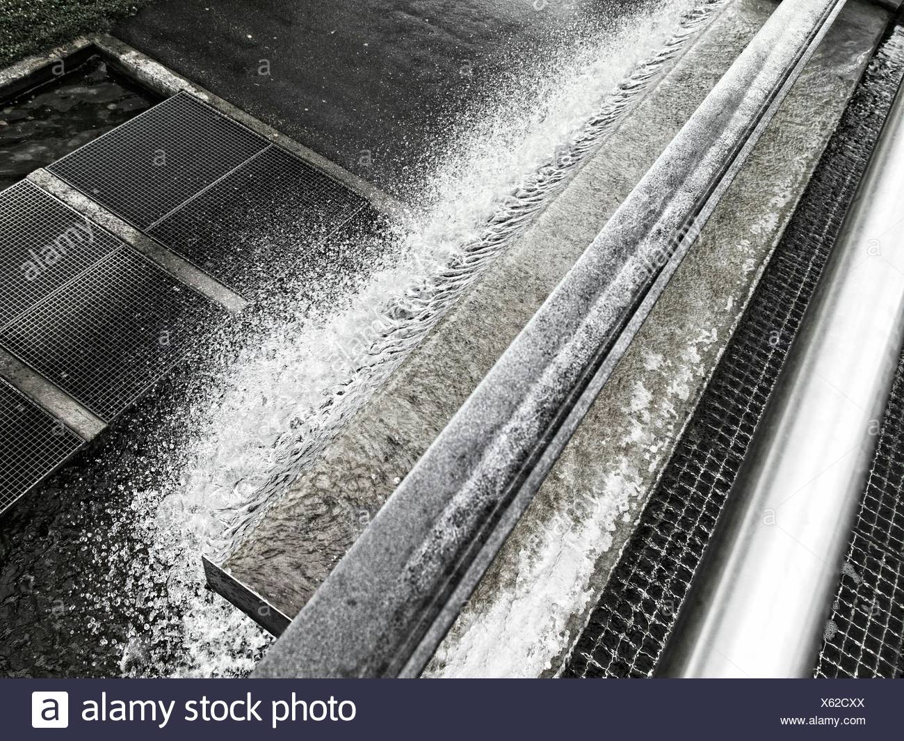 High Angle View Of Frozen Drainage By Sidewalk - Stock Image