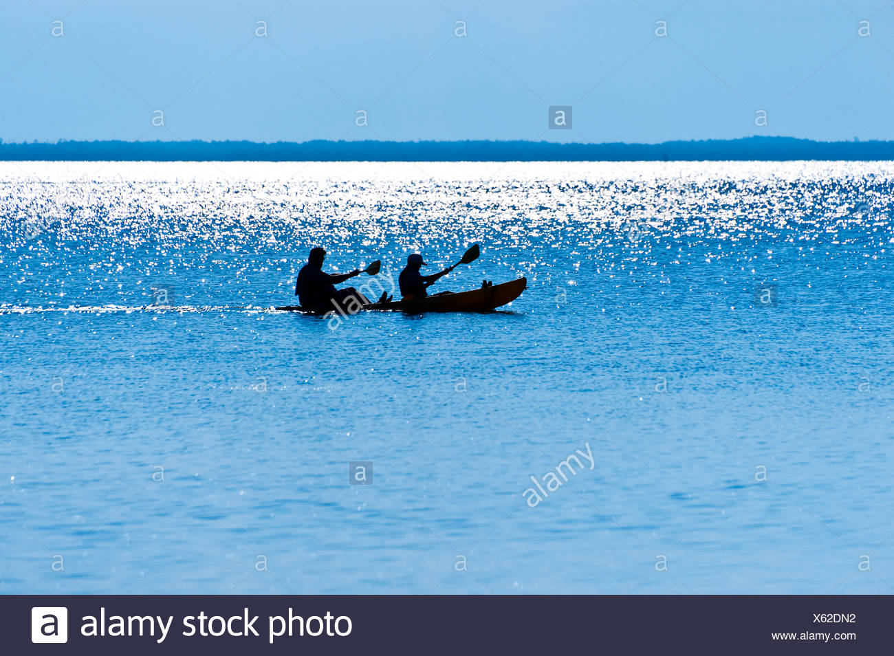 Silhouette of tandem kayakers, Outer Banks, North Carolina - Stock Image