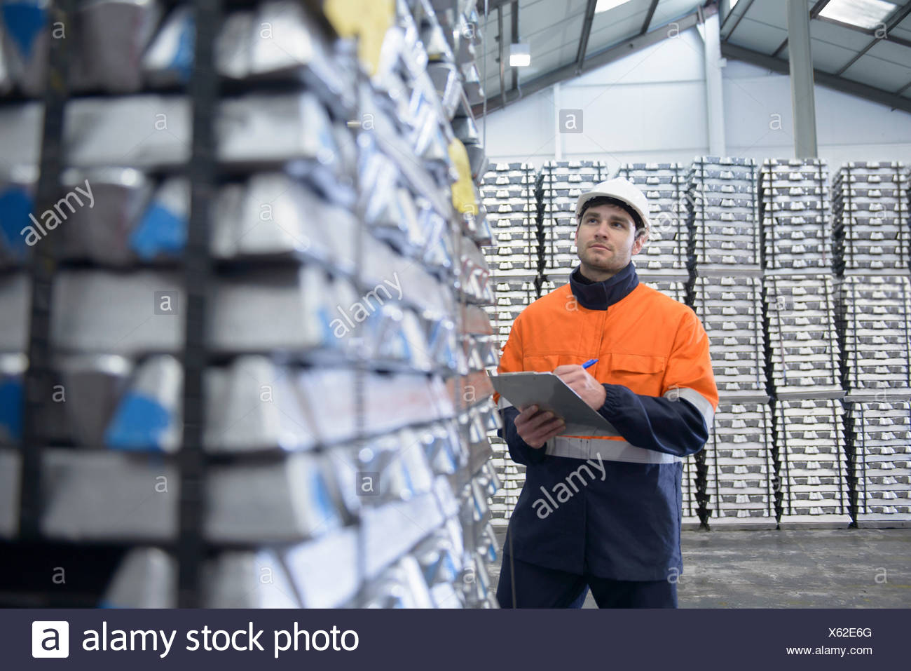 Warehouse worker checking stock - Stock Image