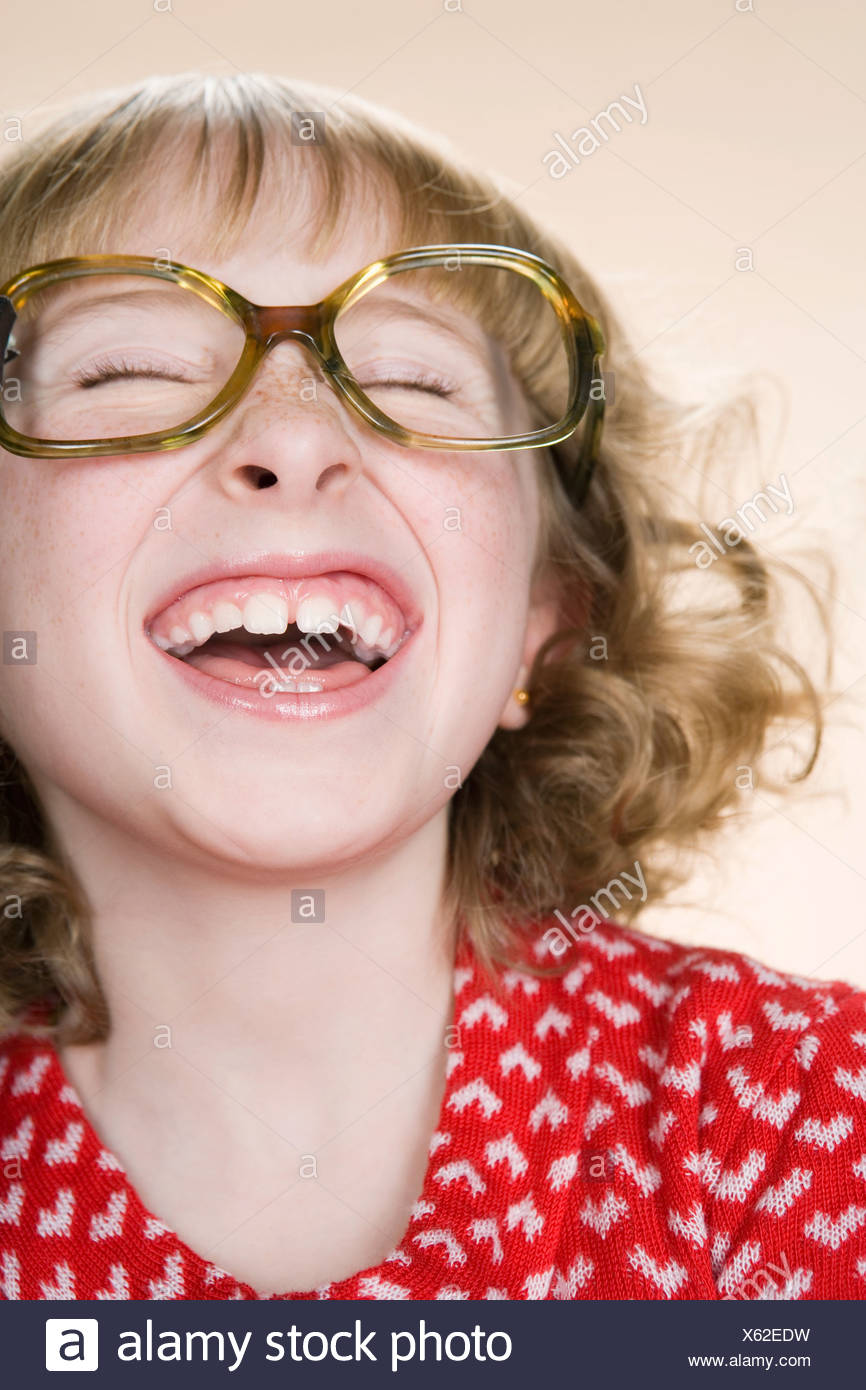 A geeky girl laughing - Stock Image
