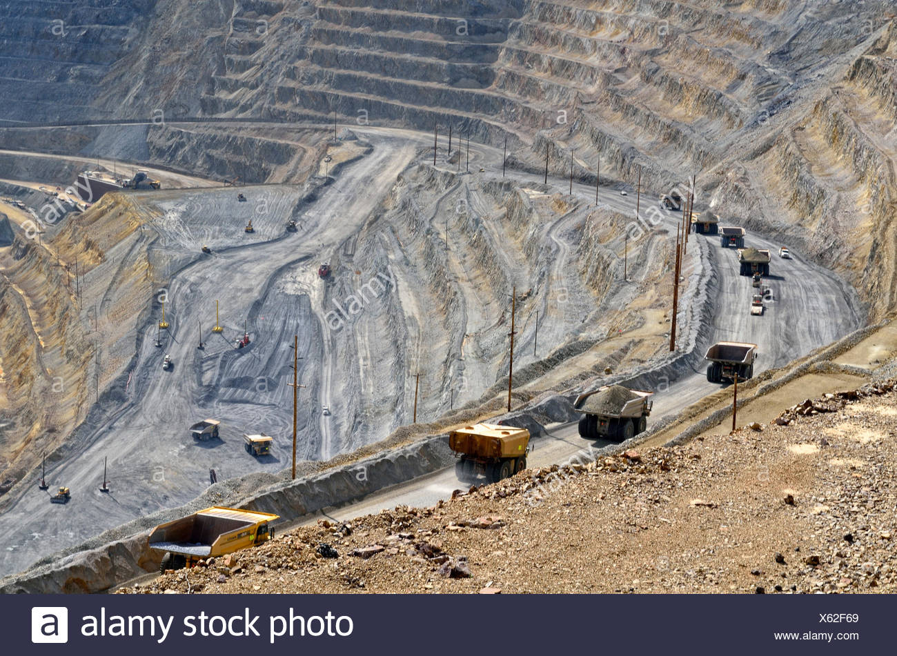 Haul trucks, heavy-duty trucks traveling in the Kennecott Utah Copper's Bingham Canyon Mine, Copperton, Utah, USA - Stock Image