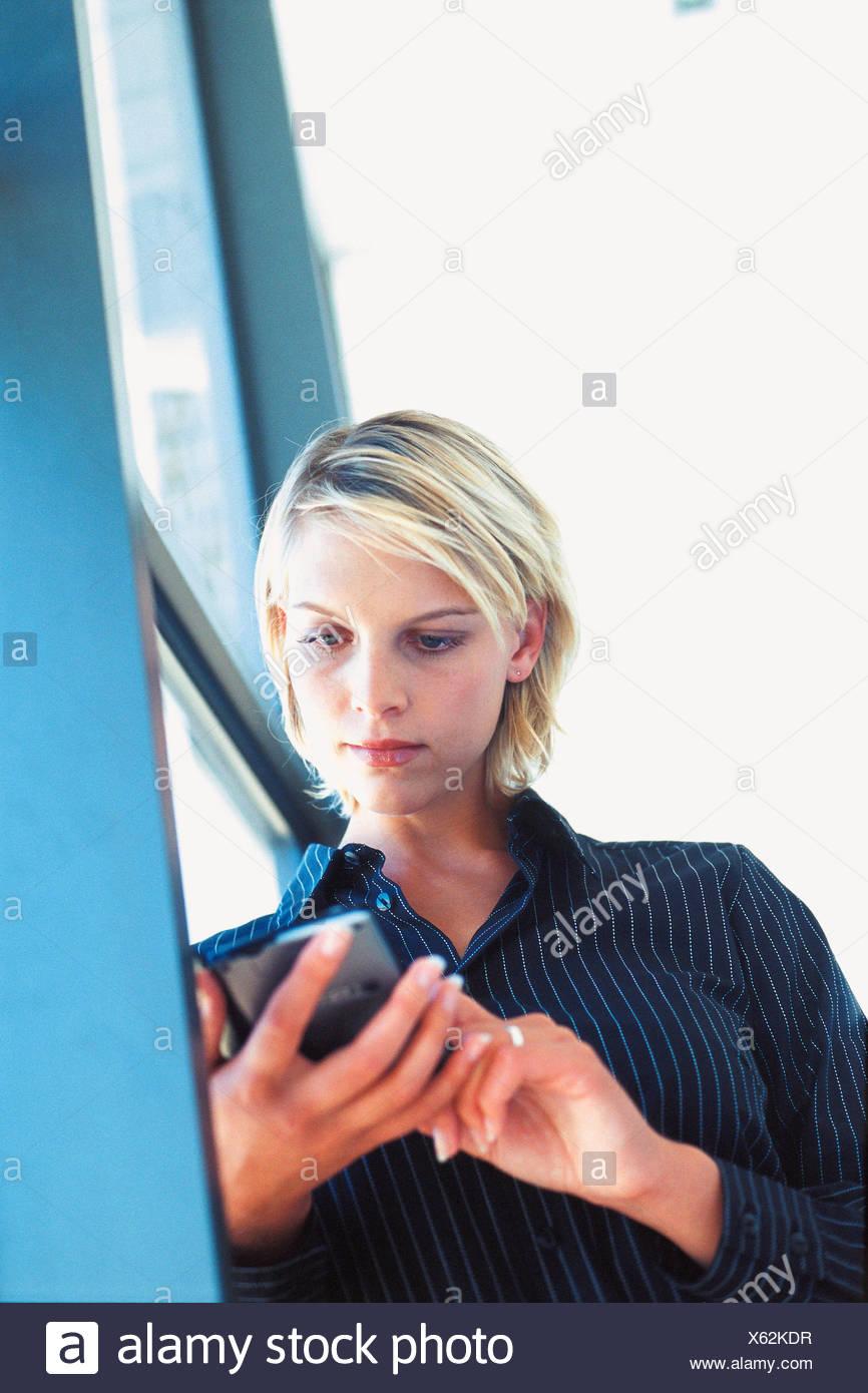 Businesswoman using personal organiser Stock Photo
