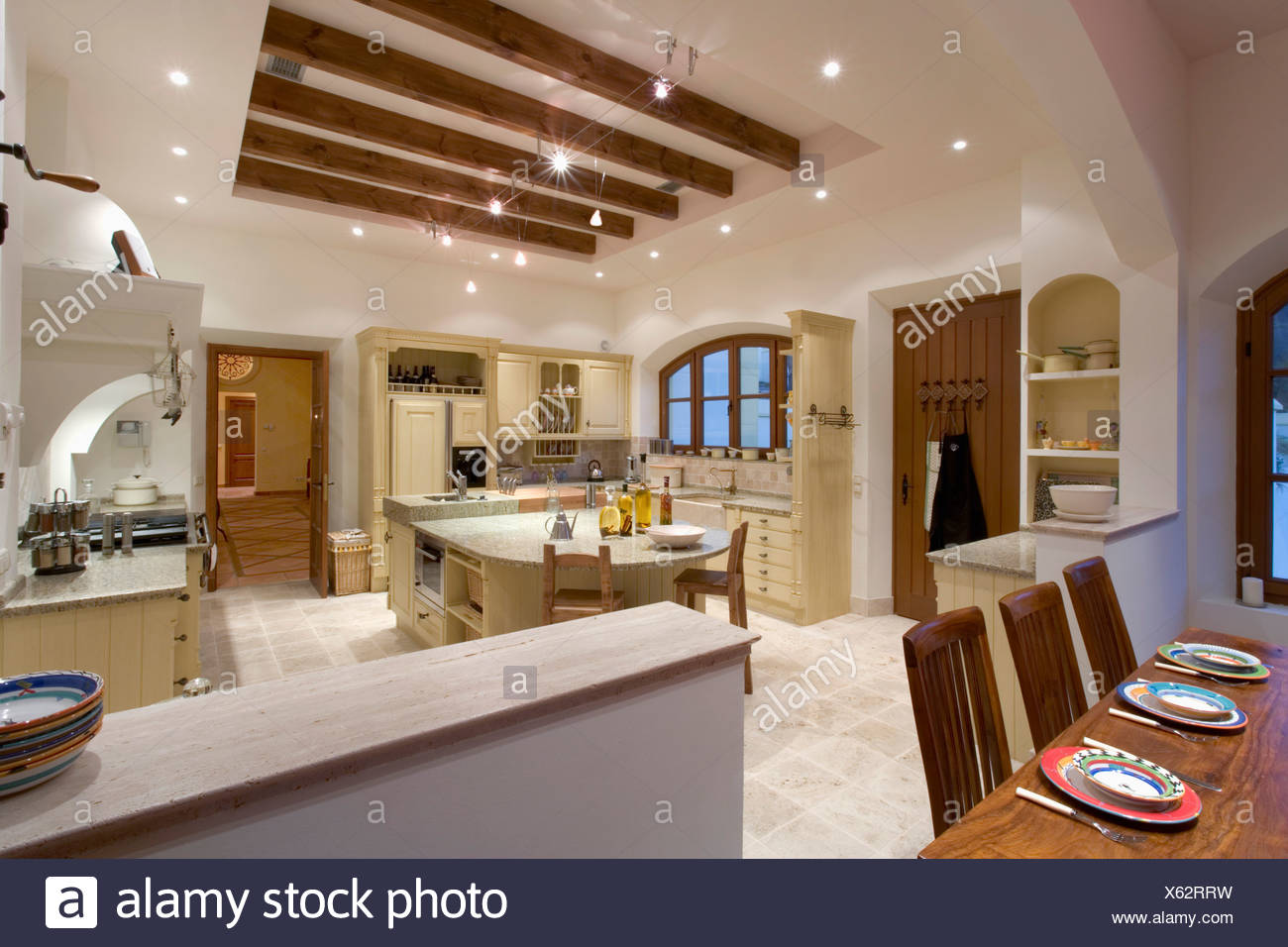 Travi A Vista Illuminazione large kitchen in spanish villa stock photos & large kitchen