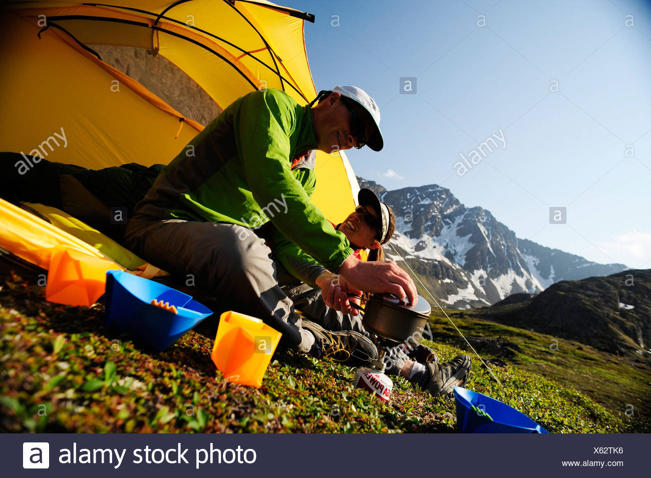 Hikers prepare a morning meal at camp on the Williwaw Lakes Trail in Chugach State Park near Anchorage,Southcentral Alaska - Stock Image
