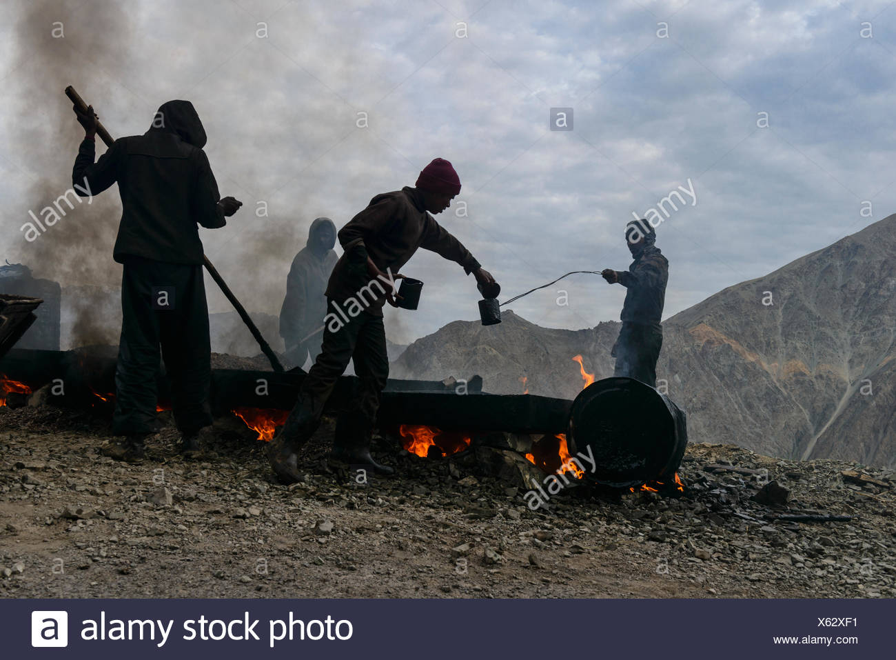 Road construction works, done under very unhealthy conditions for the workers, Lamayuru, Ladakh, Jammu and Kashmir, India - Stock Image