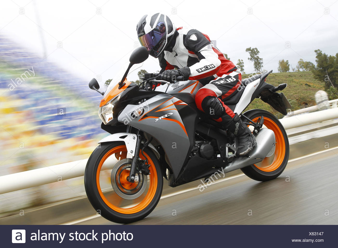 Motorcycle, Honda CBR 125R, blurred motion, moving, - Stock Image