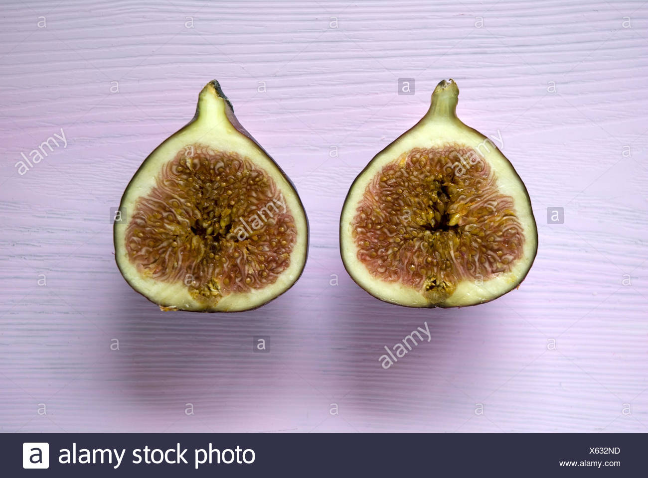 Cut open fig, - Stock Image
