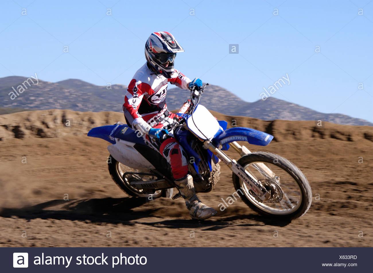 action Moto cross motor sport motorbike motorcycle running sport - Stock Image