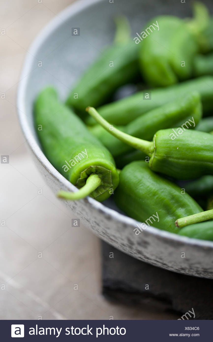 padron chilli pepper. bowl, green pepper, spicy, raw. - Stock Image