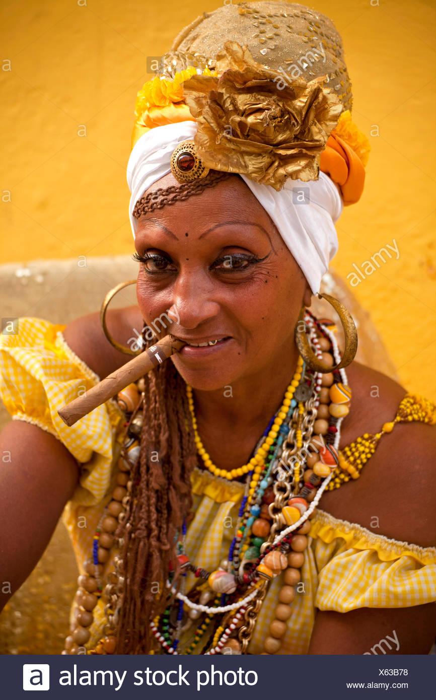Senora Habana, a priestess of the Afro-Cuban Santeria or Santera, with a cigar, Havana, Cuba - Stock Image