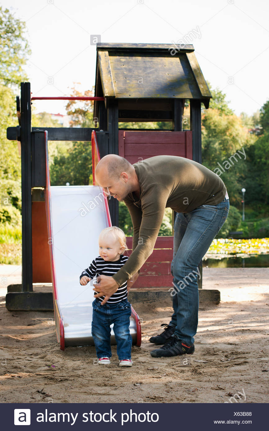 Sweden, Gotaland, Vastra, Stay at home dad playing with son (12-17 months) - Stock Image