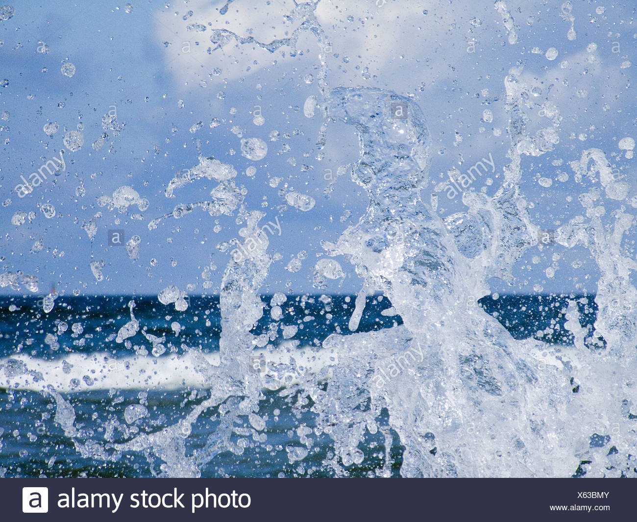 Sea, foam, close up, nature, water, waves, surf, water drop, drop, drop, drop of water, splash, nature power, spectacle of nature, colour tuning, colour, blue, light blue, - Stock Image