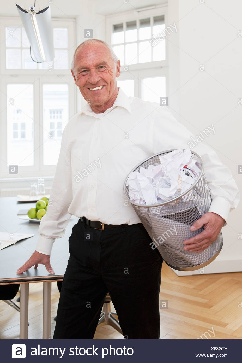 Businessman recycling waste paper - Stock Image