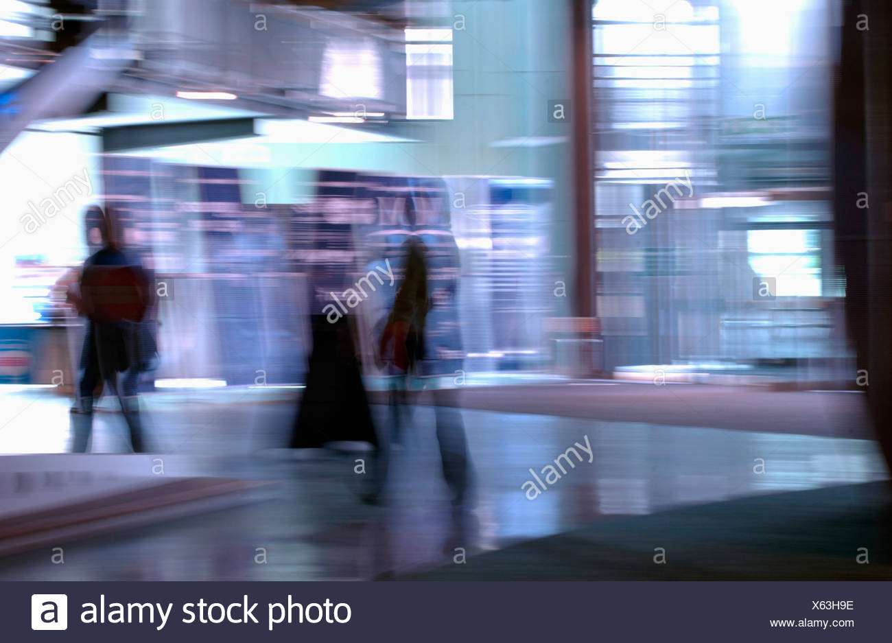 stylised view of people walking with motion blur - Stock Image