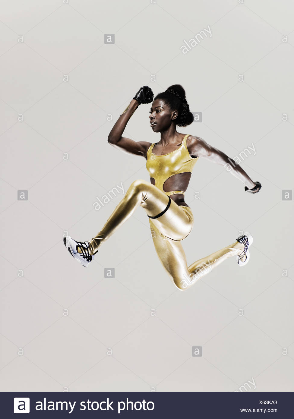 An athlete jumping - Stock Image