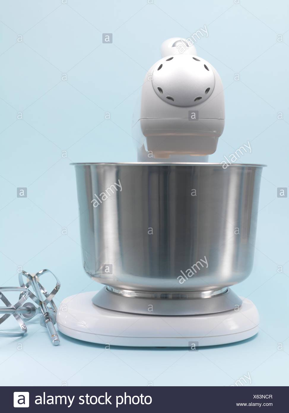 A Food Mixer Isolated Against A Blue Background   Stock Image