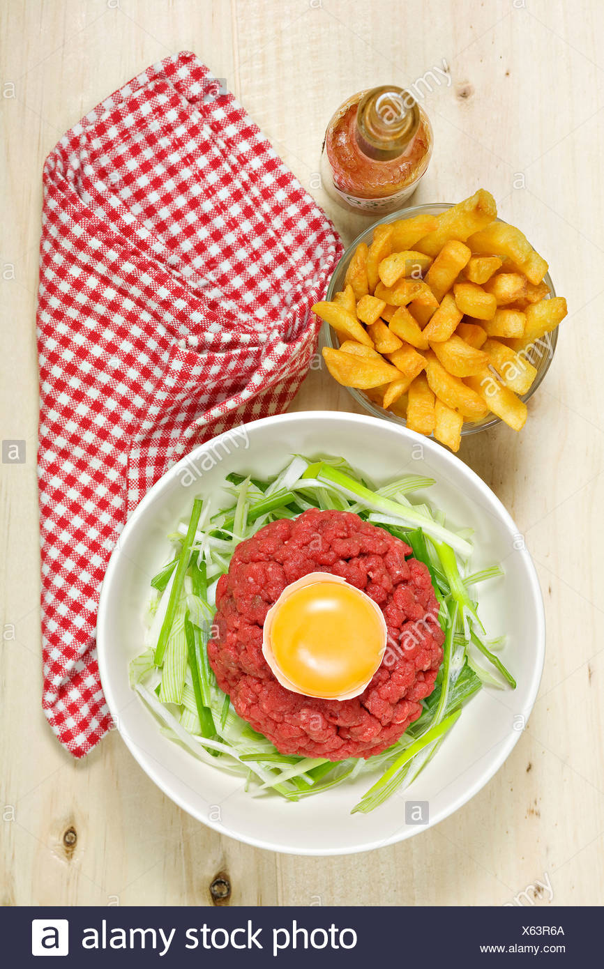 Steak tartare with french fries - Stock Image