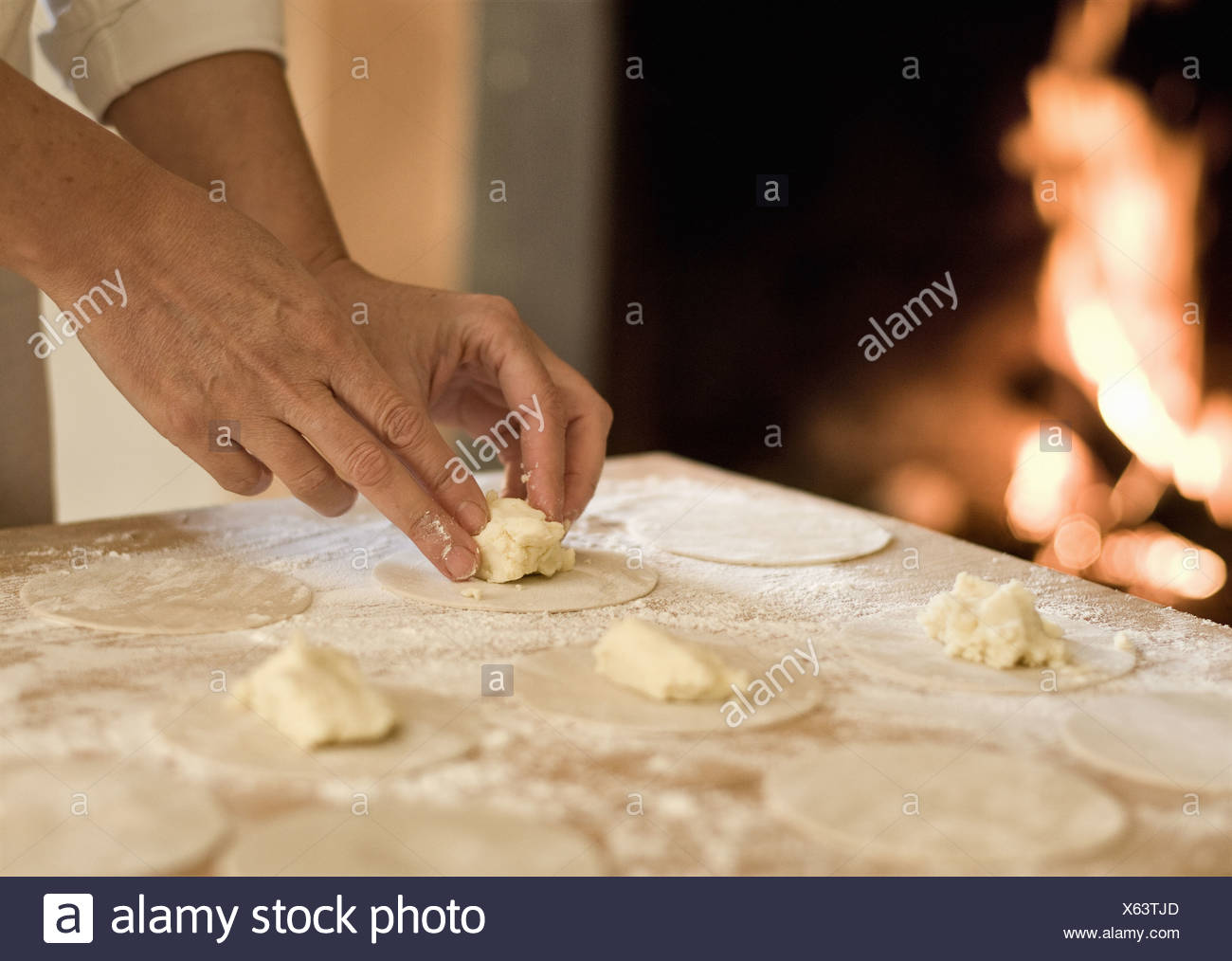 Cook filling pasta dough in kitchen - Stock Image